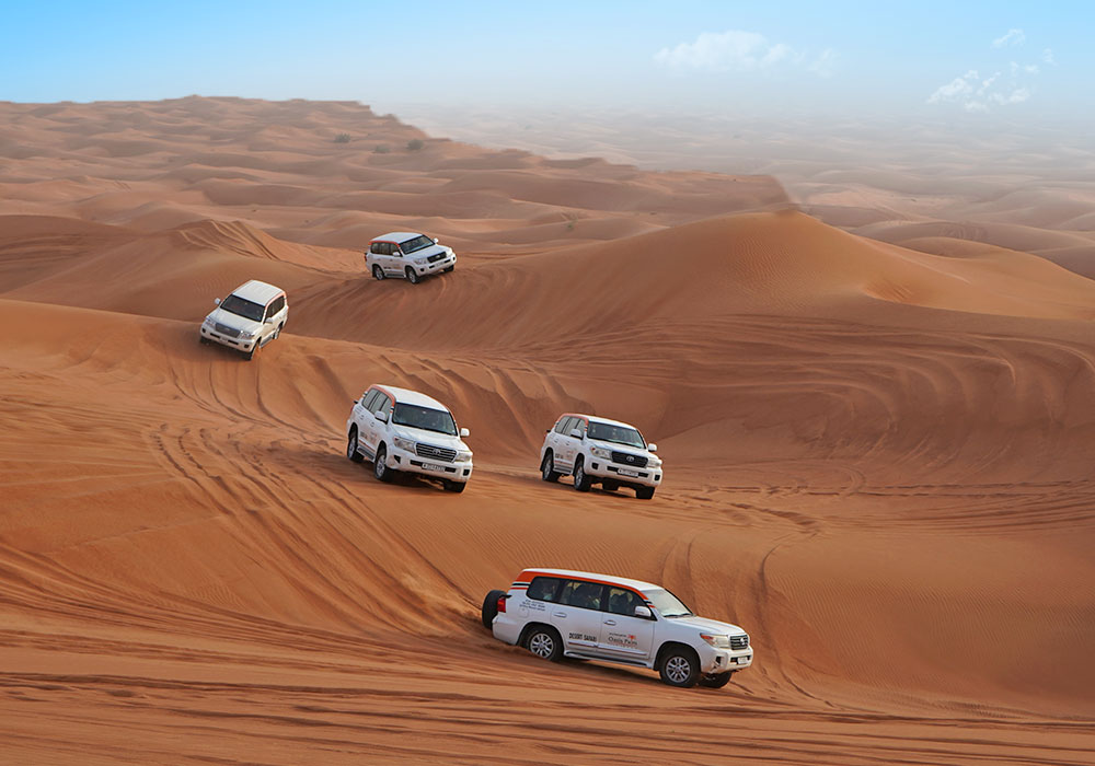 Fleet of Land cruisers moving in a convoy