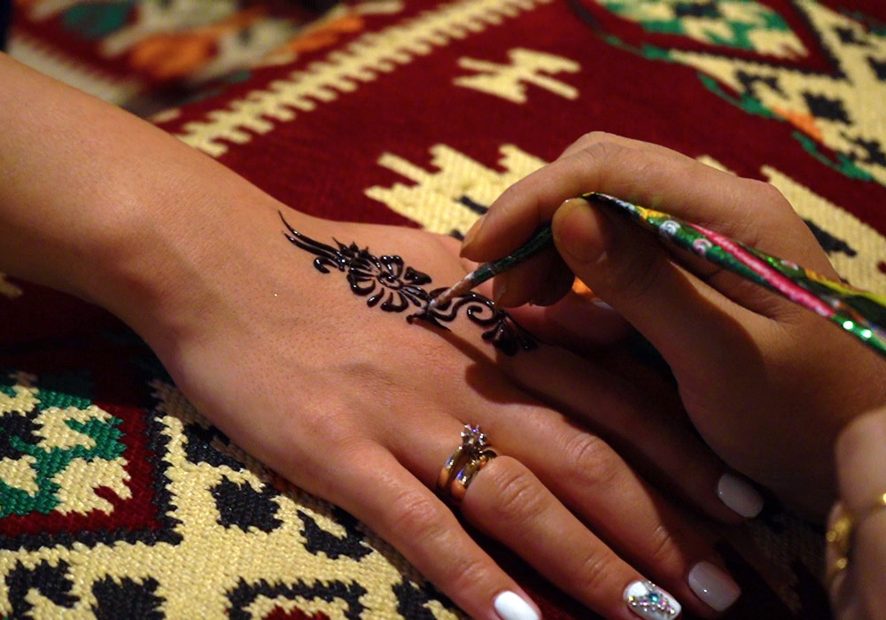 Henna painting is included in the Desert Safari package