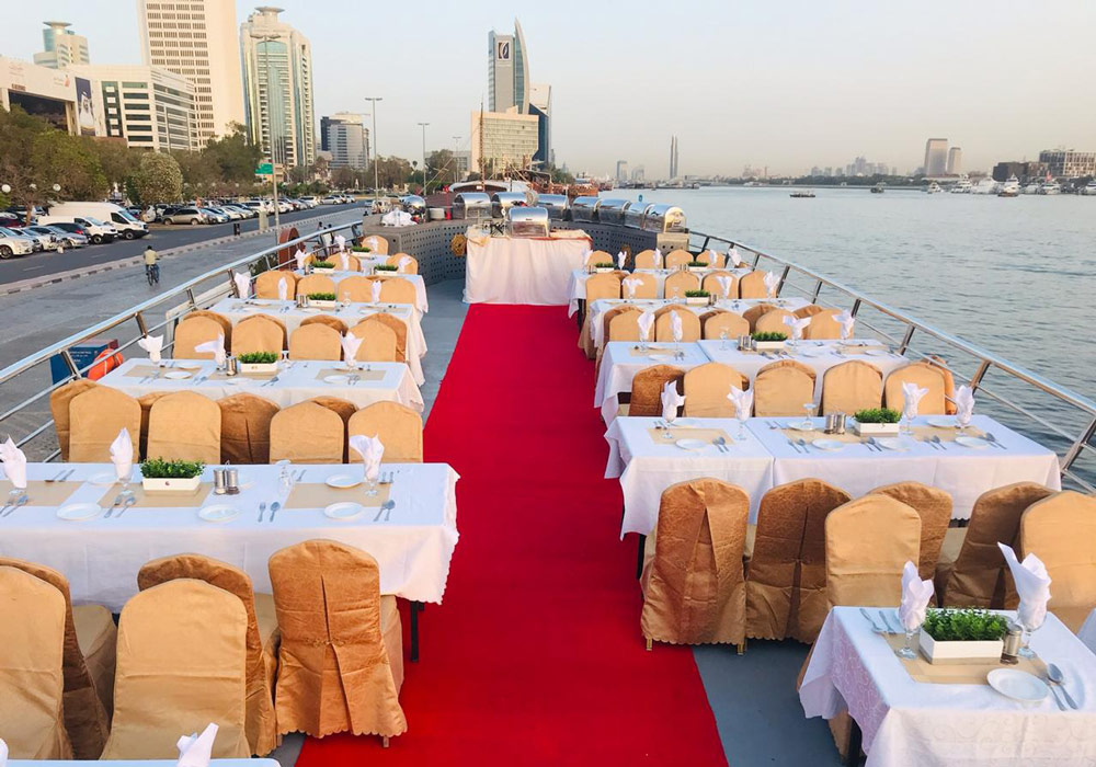 Choose between an air-conditioned deck or an open-air deck in the Dhow Cruise