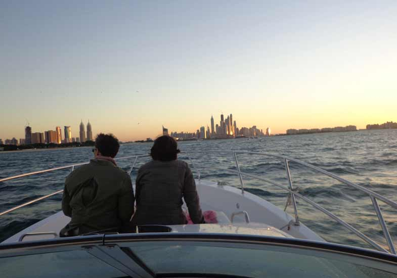Couple on a boat watching sunset